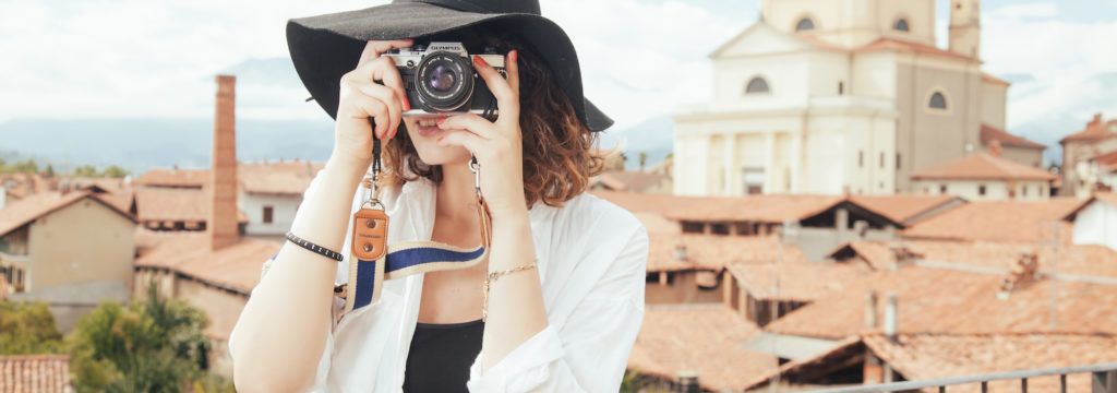 how to get travel clients, traveler with camera