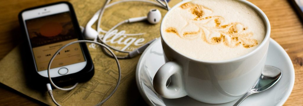 travel agent podcasts iphone and coffee
